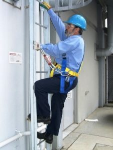 man going down laddr after testing fume cupboard