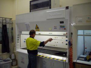 man testing fume cupboard, maintenance
